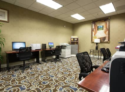 Business Center With Computer Workstations, Ergonomic Chairs, Wall Art, Printer, and Fax/Copier