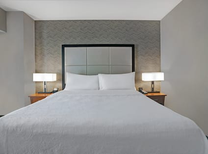 guest room with bed and night tables