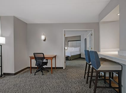 guest room with work desk and bed