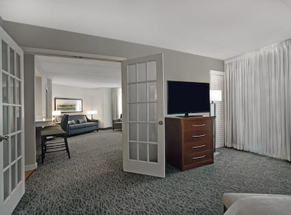 guest room with television and view to lounge area