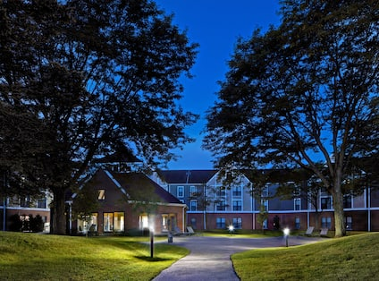 exterior garden and hotel at dusk