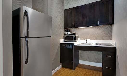 guest room kitchen with appliances
