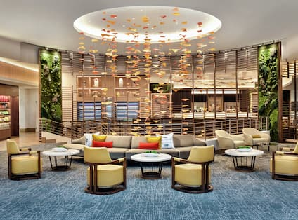 Lobby Area with Barrel Style Chairs and Artistic Light Element