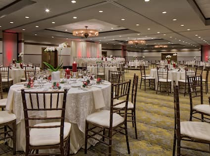 Spacious Ballroom Dining Setup with Round Tables and Chairs