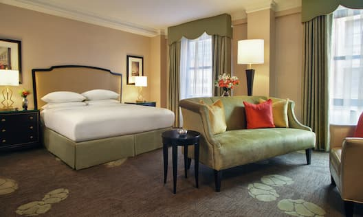 Business Class King Guestroom with Bed and Lounge Area