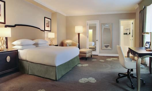 Executive King Bedroom with Bed, Lounge Area, Work Desk, and Bathroom