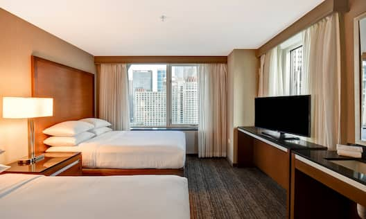 Guest Room with Two Beds HDTV and City View