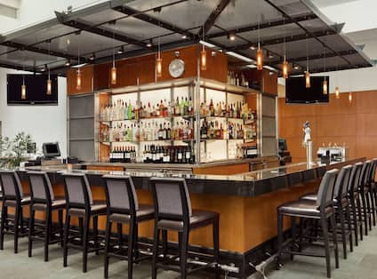 Bar with chairs and drinks behind counter
