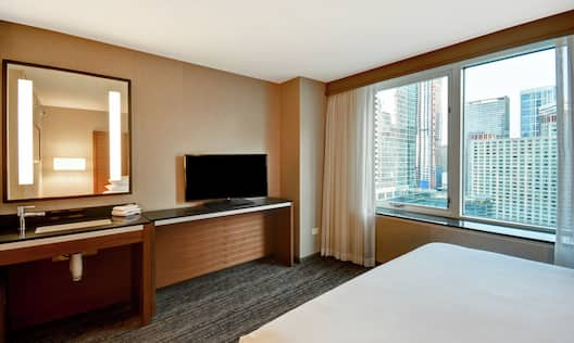 Bed with TV and mirror