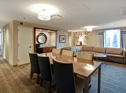 Suite living area with tables and chairs