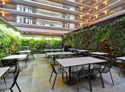 Outdoor terrace with tables and chairs