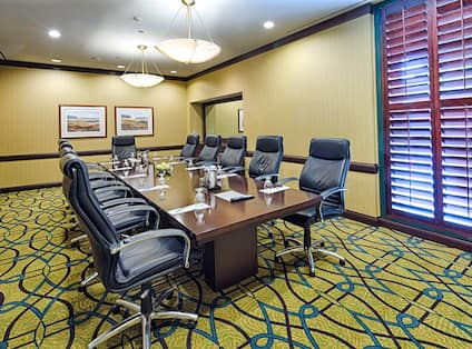 Boardroom East Meeting Space with long table and chairs