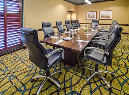 Boardroom West Meeting Space with long table a chairs