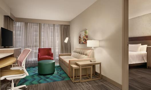 Suite Living Area with Sofa Bed TV and Desk