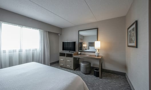 King Bedroom with TV and Large Mirror