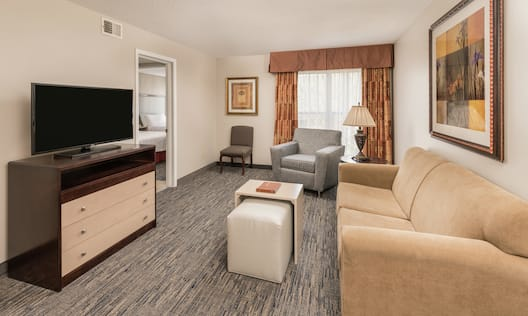 Guest Suite Living and Lounge Area with Sofa, Arm Chair, and HDTV
