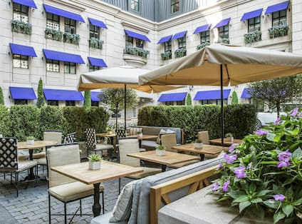 Hotel Courtyard - Tables, Chairs and Umbrella