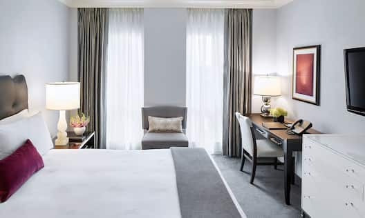 Grand Deluxe Room with king bed and work desk