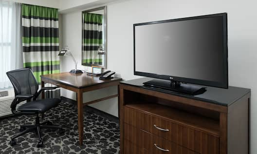 Guest Room Entertainment Center with desk and TV