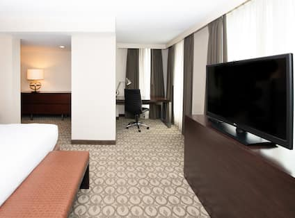 King Suite Bedroom With Work Desk and Flat Screen TV