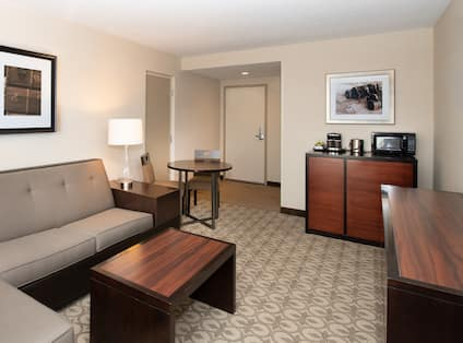 Suite Living Room Seating and Cabinet with Microwave and Coffee Maker
