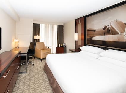 King Bed and Flat Screen TV in Suite Bedroom