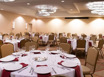 Banquet Round Tables Set for Dinner in Meeting Room