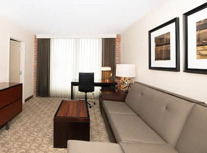 Suite Living Room with Sofa, Desk and TV