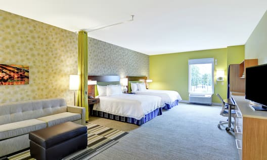 Two Queen Beds, Sofa, Work Desk, and TV in Accessible Suite with Outside View