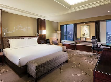 Suite with King Bed and Chair