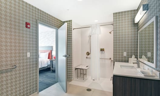 Accessible Bathroom with Roll-in Shower and Bench Seat