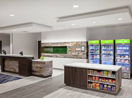 Front Desk Reception Area with On-Site Market