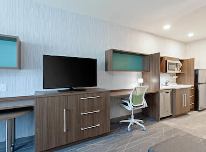 One King Bed Guest Suite with TV, Work Desk and Kitchen Area