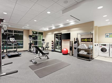 Fitness Center with Weight Bench, Treadmill and Weight Machine