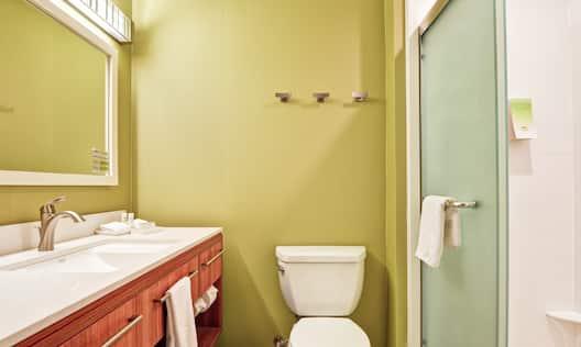 Vanity and Shower in Suite Bathroom