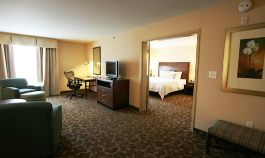 Executive Suite with Living and Lounge Area, Work Desk, and Television