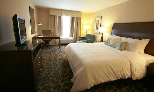 Guest Room with Luxurious King Bed, Work Desk, and HDTV