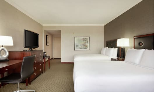 Spacious Guest Rooms featuring Two Double Beds