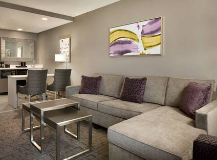 Guest Suite Living Room with Sofa, Coffee Table, Work Desk and Beverage Station
