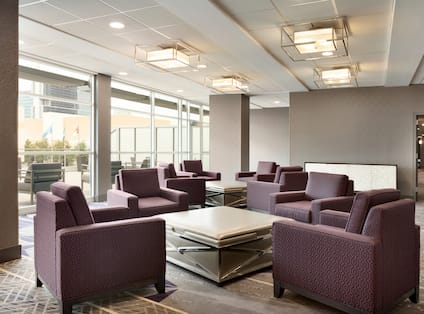 Lobby Seating Area with Armchairs and Coffee Table