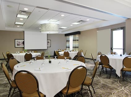 Ballroom Meeting Room Round Tables Screen Projector