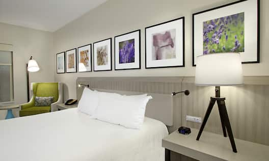 Room with Bed and Wall Art