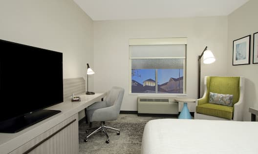 Room with Bed, Work Desk, and TV