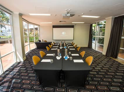 Meeting Room with Tables, Chairs and Projector Screen