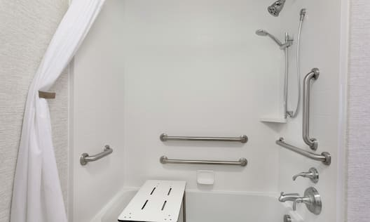 Accessible Bathtub with Seat and Grab Bars