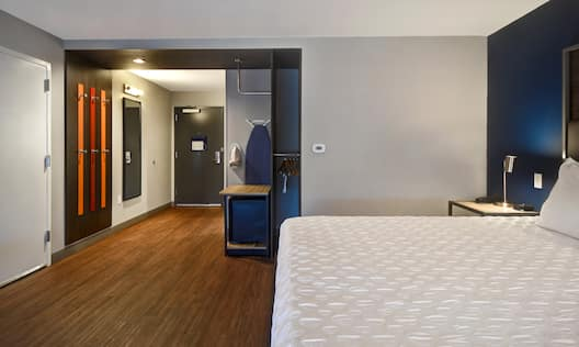 guest room with bed and entry