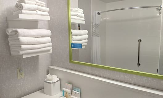 Nonsmoking Two Queen Studio Suite Bathroom with Mirror, Shower, and Bathtub