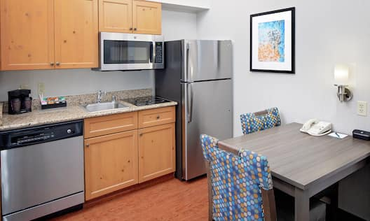 Kitchen area with fridge and microwave