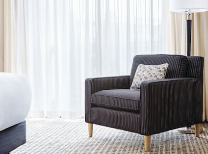 Soft Chair with Cushion in a Hotel Room