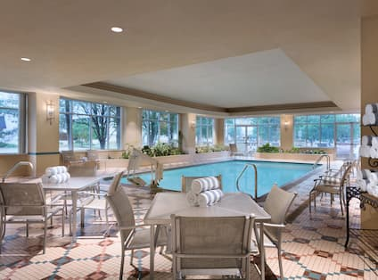 Indoor Pool with tables and chairs